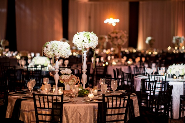 black-and-white reception décor, white and green flowers ambient lighting