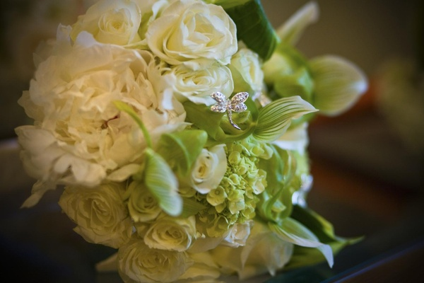 White bridal bouquet with rose and butterfly jewel