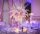 ashley alexiss wedding reception tall centerpiece white pink flowers silver chairs candles drapes