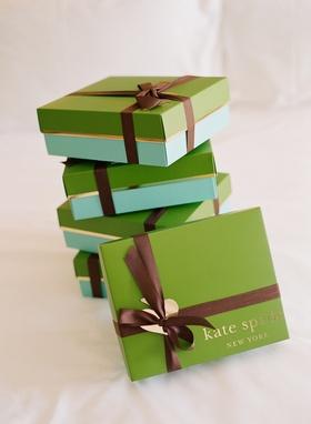 Designer Kate Spade boxes wrapped in brown ribbon
