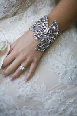 Jenny Packham bracelet with halo engagement ring