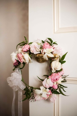 Flower headband with pink and white roses on door handle