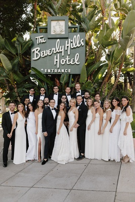 wedding party bridesmaids in white bridesmaid dresses groomsmen in tuxedos bow ties beverly hills