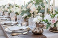 wedding reception table wood with dark metallic bronze vase antique glassware white flowers gold