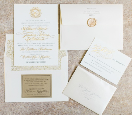 White and gold wedding invitation suite with gold wax seal and gold calligraphy