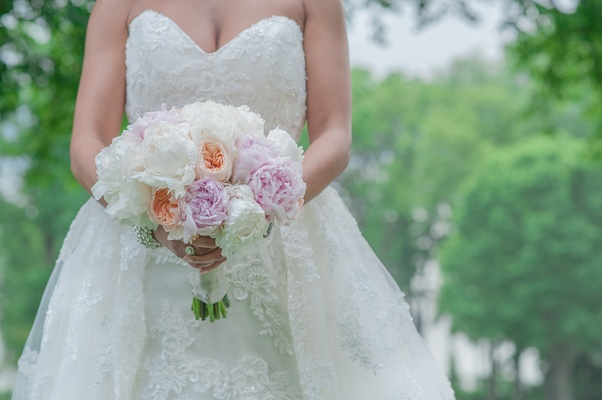 bridal bouquet with ivory and blush peonies and peach garden roses