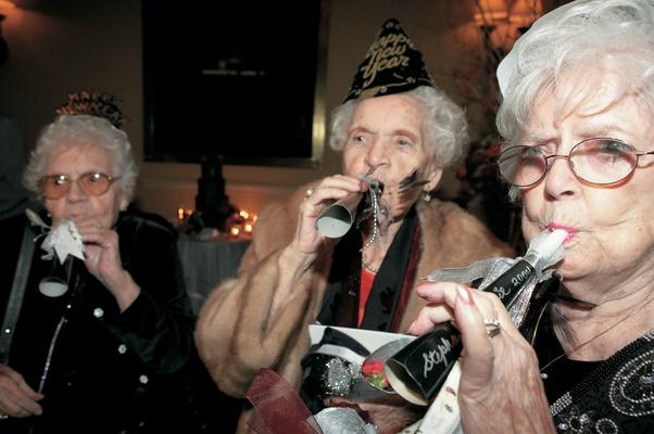 Elder women blew on noise makers