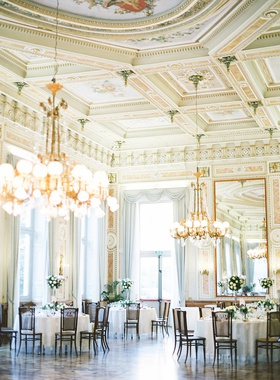 wedding reception lake como italy hand painted ceilings gold chandelier cane back chairs flowers