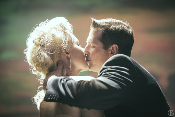 Old-fashion style bride and groom kissing