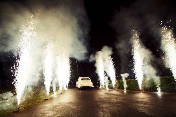 White vintage getaway car through firework tunnel