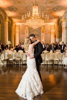 Bride and groom have their first dance at biltmore ballrooms under massive chandelier Ines Di Santo