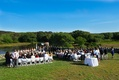 Martha's Vineyard lake ceremony with trees and simple decor