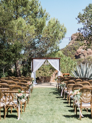 Megan Nicole youtube singer outdoor wedding wood vineyard chairs wood arbor drapery backyard wedding