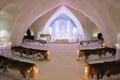 wedding ceremony in ice castle snowy aisle ice pews faux fur candlelight lighting