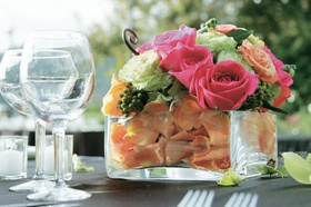 Colorful flower centerpiece for outdoor wedding reception