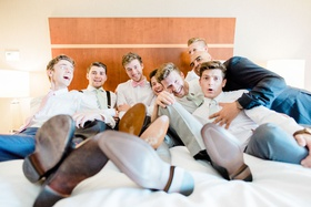 Funny photo groom groomsmen getting ready on bed photo like bridesmaid photo classic