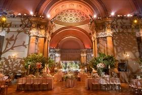 Wedding reception lighting projections vines trees weylin brooklyn greenery bright flowers