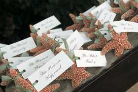 Real starfish tied to wedding place cards