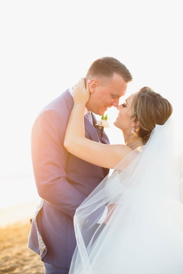 wedding portrait bride veil blowing in wind close almost kiss sunset on beach california