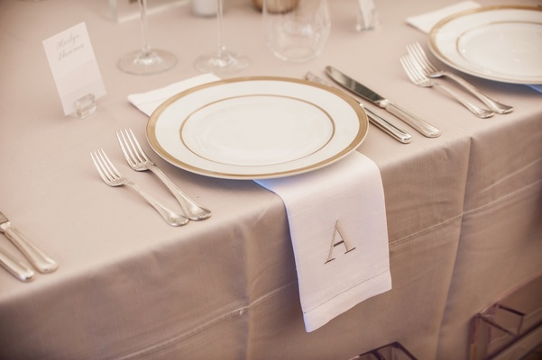 Neutral wedding table reception decor tan linen white napkin with tan monogram A initial