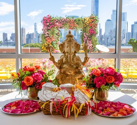 wedding table at ceremony with programs and rose petals bright multicultural wedding indian japanese