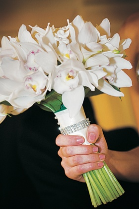 Brides's bouquet of white cymbidium orchids, calla lilies, and stephanotis flowers