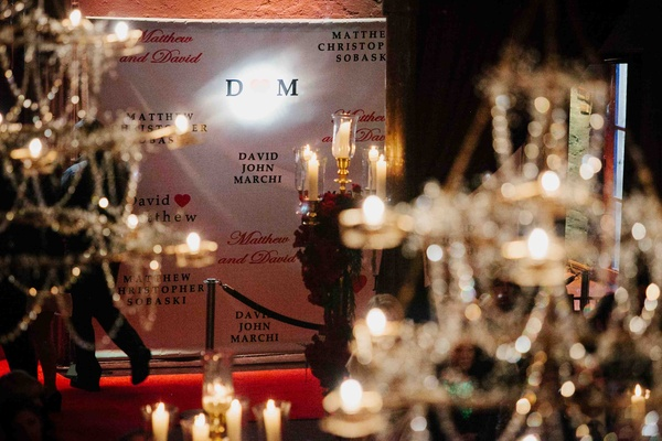Wedding reception with a step-and-repeat backdrop for red-carpet-style photos