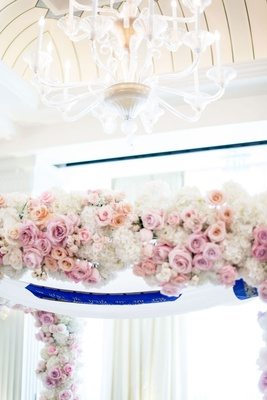 wedding ceremony chuppah pink apricot rose flowers white hydrangea chandelier overhead drapery
