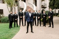 groom shane vereen nfl player in navy tuxedo with groomsmen black white suits boutonniere