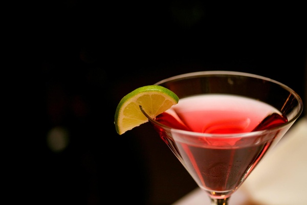 Red martini with lime wedge served at wedding