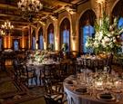 lavish ballroom with chandeliers and ornate windows
