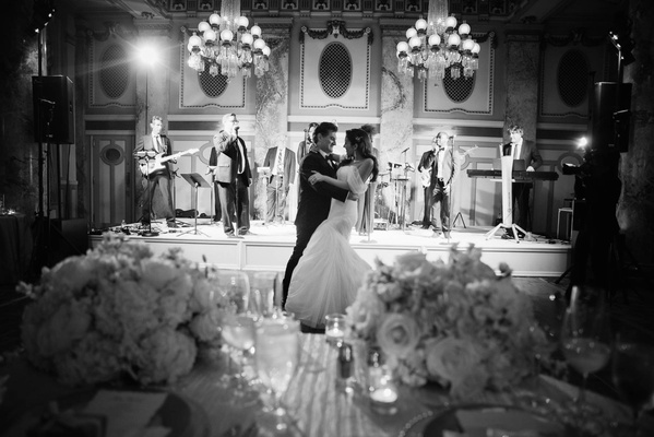 black and white photo of newlyweds' first dance, bride in monique lhuillier gown