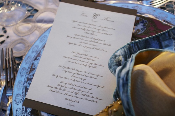 Script font wedding dinner menu card on table