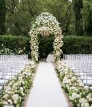 Wedding ceremony at The Beverly Hills Hotel white rose hydrangea flowers chuppah aisle runner
