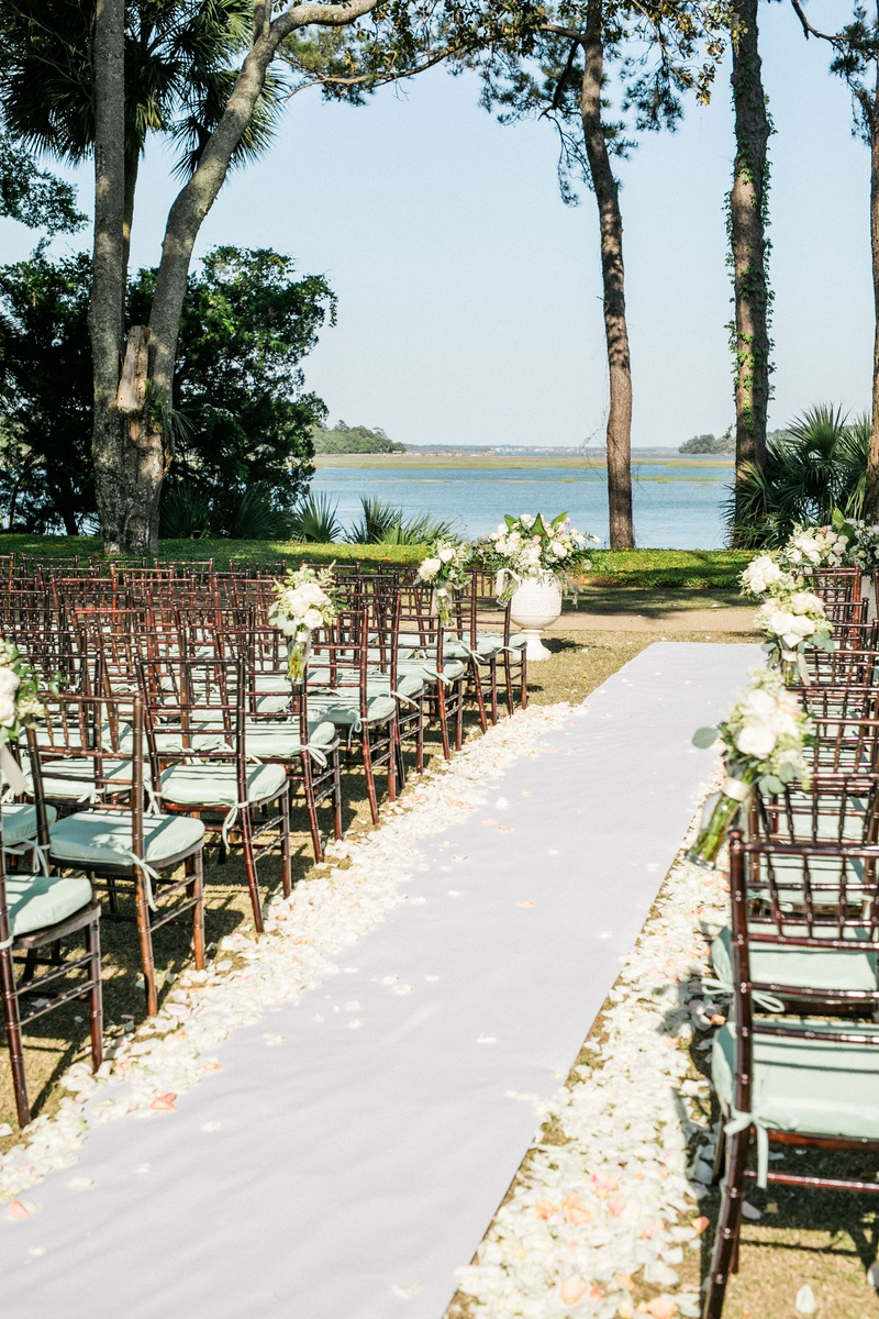 the original runner company white non slip aisle runner white pink flower petals brown chairs mint