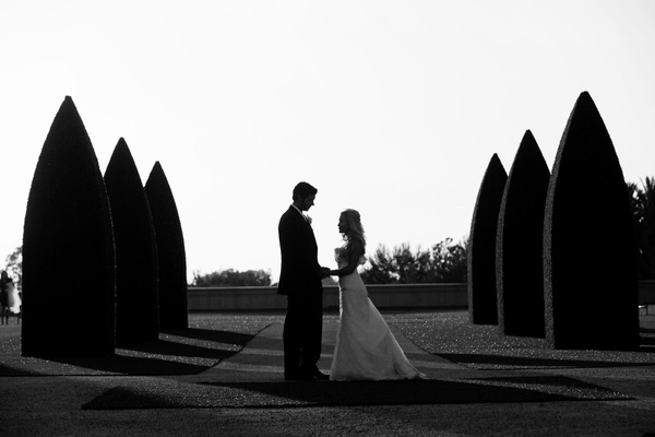 Black and white photo of newlyweds on lawn