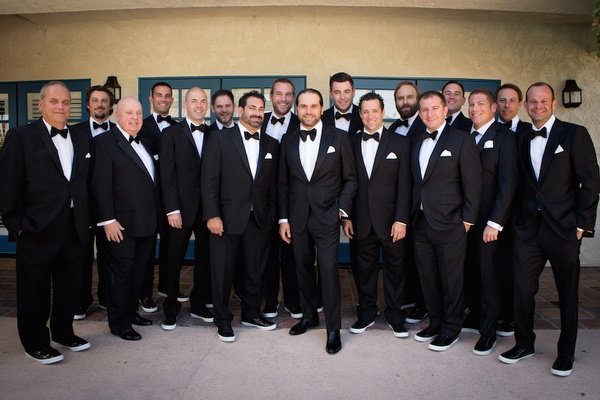 Black and white tuxedo with bow tie groomsmen outfits