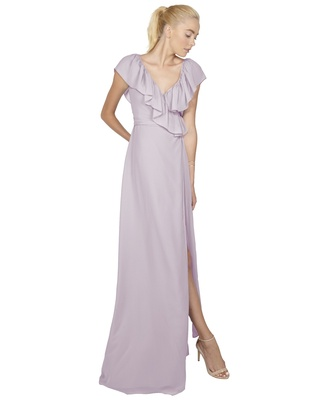 The full ruffle neckline of the Lolo dress is dramatic and ethereal, perfect for making a statement
