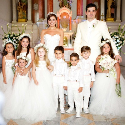 bride and groom stand with adorable flowers girls and ring bearers after the ceremony colombia