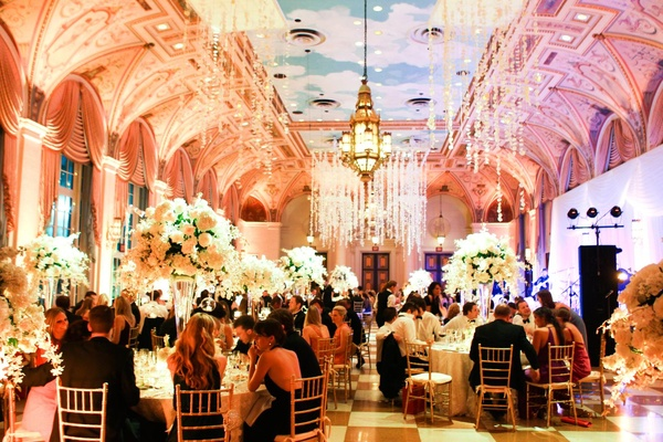 crystals hang from ceiling of mediterranean themed ballroom