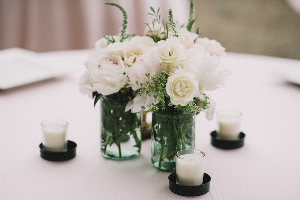 Candle votives and mason jars with white flowers