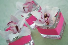 Rectangular vessel holding light purple orchid blossom