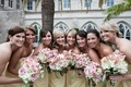 Bridesmaids in yellow dresses holding pink bouquets