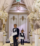 shannon perkins and tahir whitehead kids wagon cute signs around necks white gold ballroom decor