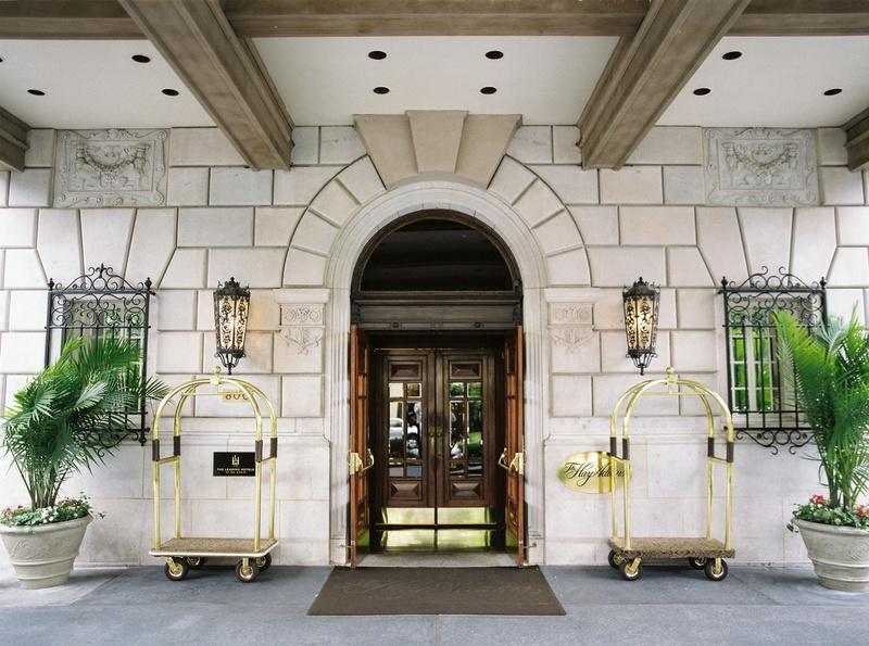 Wedding reception location The Hay-Adams in Washington, DC bellhop carts plants sconces