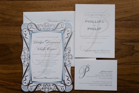 white silver and light blue wedding invitation suite with response card invitation attire details