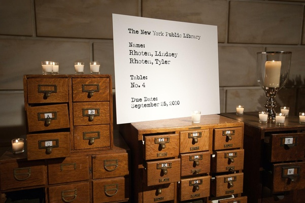 Wedding escort cards in form of card catalog for library venue