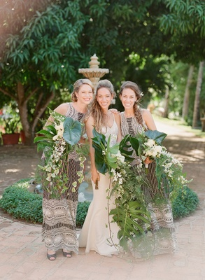 Bride with sisters braids cascading palm frond unique bouquets wedding ideas sequin bridesmaid dress
