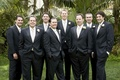 Groom and groomsmen in tuxedos with light ties