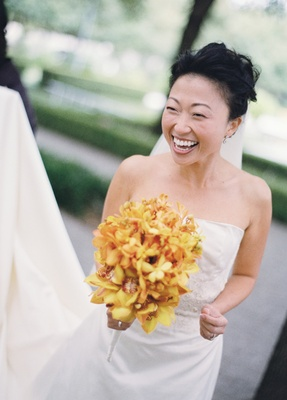 Bride in a strapless dress with a bouquet of yellow flowers
